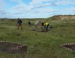 Emergency turf stripping works for rare mosses by AONB volunteers at Aberffraw
