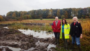 Martin Hammond, Anne Heathcote and Mick Phythian by the newly extended pond