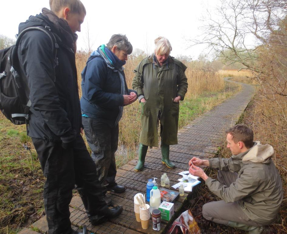 Project Officer Pete shows volunteers how to use testing kits to monitor water pollution levels on Cothill Fen Flagship Pond site, one of the finest freshwater sites in southern England. Photo credit: Judy Webb